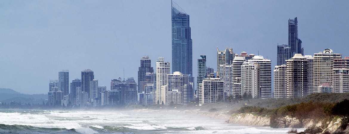 Rough waves at a Gold Coast beach with highrise buildings in the background