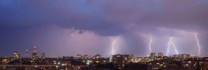 Lightning over city scape.