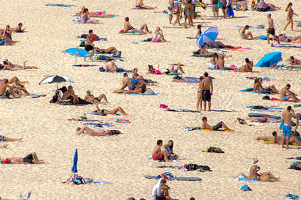 Many people on the sand at Bondi Beach