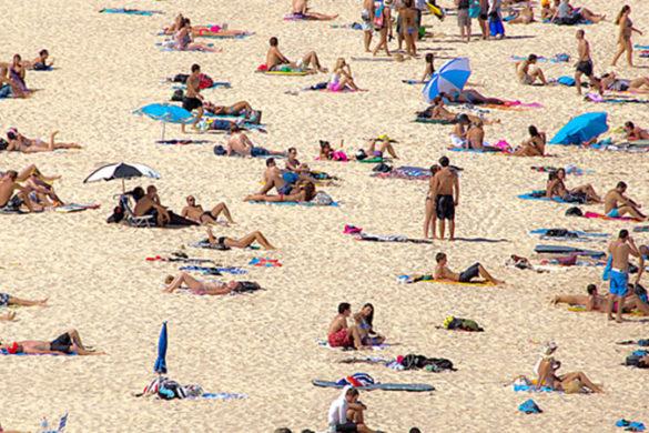 Many people on the sand at Bondi Beach