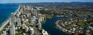 Aerial view of Gold Coast showing beach, highrise buildings, canals and homes