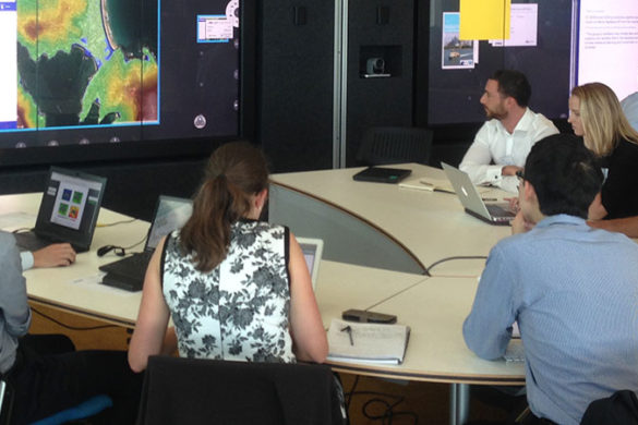 Young risk professionals and climate scientists sitting around a desk