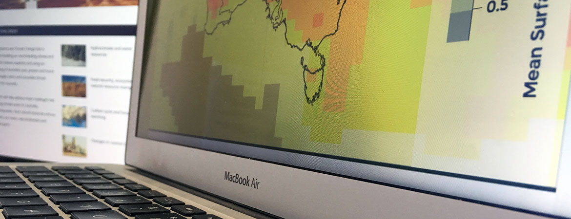 Laptop screen showing partial climate projections map